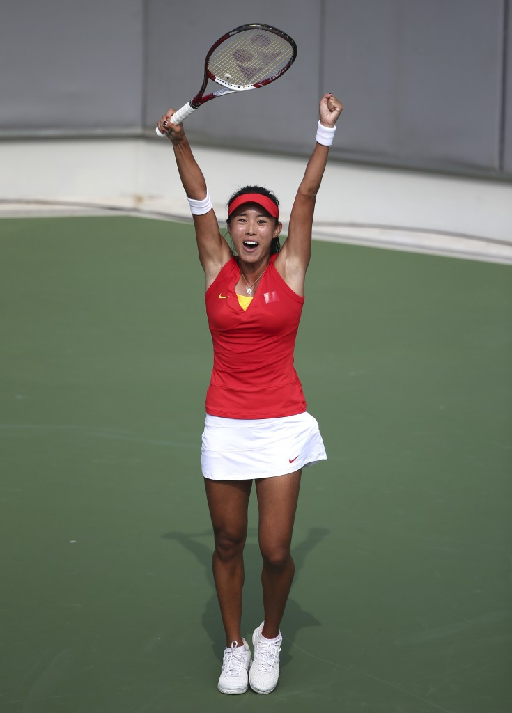 China's  Wang Qiang raises her arms up hi as she celebrates winning her women's tennis final against Thailand's Luksika Kumkhum at the 17th Asian Games in Incheon, South Korea,  Tuesday, Sept. 30, 2014.(AP Photo/Rob Griffith)