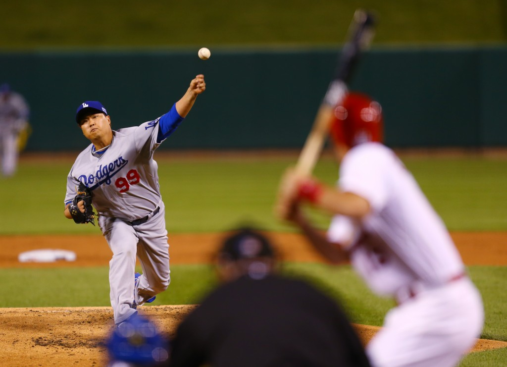 Los Angeles Dodgers starting pitcher Hyun-Jin Ryu throws a pitch during the first inning of Game 3 of baseball's NL Division Series against the St. Louis Cardinals, Monday, Oct. 6, 2014, in St. Louis. (AP Photo/Dilip Vishwanat, Pool)