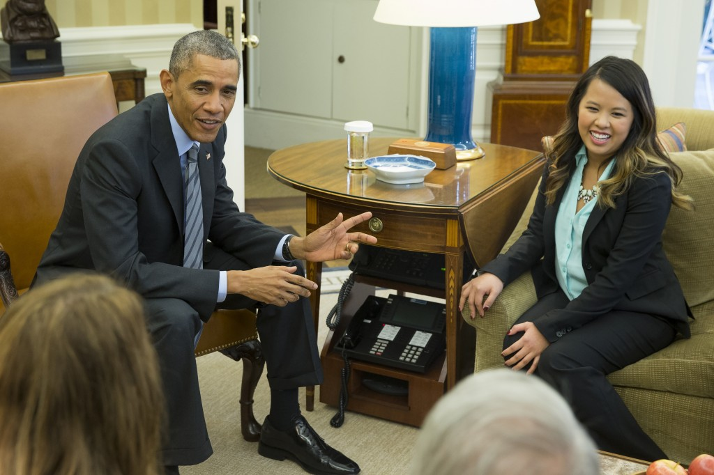 President Barack Obama meets with Ebola survivor Nina Pham in the Oval Office of the White House in Washington, Friday, Oct. 24, 2014.   (AP Photo/Evan Vucci)