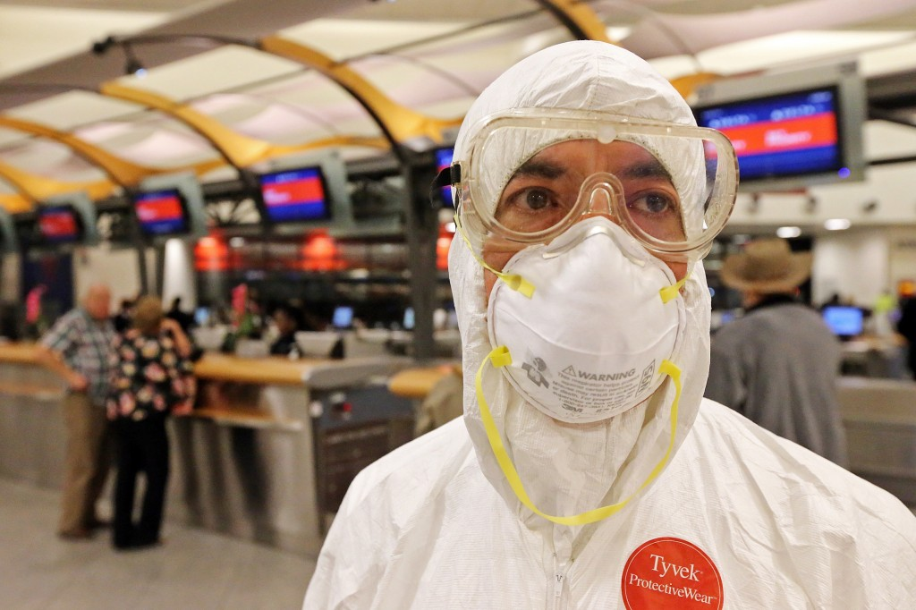 Two days after a man in Texas was diagnosed with Ebola, Dr. Gil Mobley, a Missouri doctor, checked in and boarded a plane dressed in full protection gear Thursday morning, Oct. 2, 2014, at Hartsfield-Jackson Atlanta International Airport. He was protesting what he called mismanagement of the crisis by the federal Centers for Disease Control and Prevention. (AP Photo/Atlanta Journal-Constitution, John Spink)