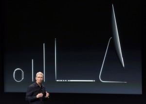 Apple CEO Tim Cook discusses the new Apple product line-up during an event at Apple headquarters on Thursday, Oct. 16, 2014 in Cupertino, Calif. (AP Photo/Marcio Jose Sanchez)