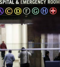 People walk through the lobby of Bellevue Hospital, Friday, Oct. 24, 2014, in New York. Dr. Craig Spencer, a resident of New York City and a member of Doctors Without Borders, was admitted to Bellevue on Thursday and has been diagnosed with Ebola. (AP Photo/Mark Lennihan)