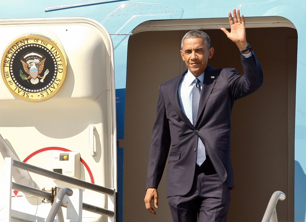 President Barack Obama steps off of Air Force One at Los Angeles International Airport, Thursday, Oct. 9, 2014, in Los Angeles. (AP Photo/Damian Dovarganes)