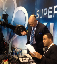 Hines Ward goes over production notes before a Superbowl broadcast (Courtesy of Andrew Ree)