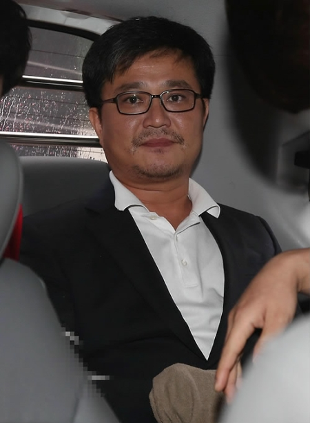 Kim Hyung-sik, a 44-year-old Seoul city councilman, was sentenced to life in prison on Monday. (Yonhap)