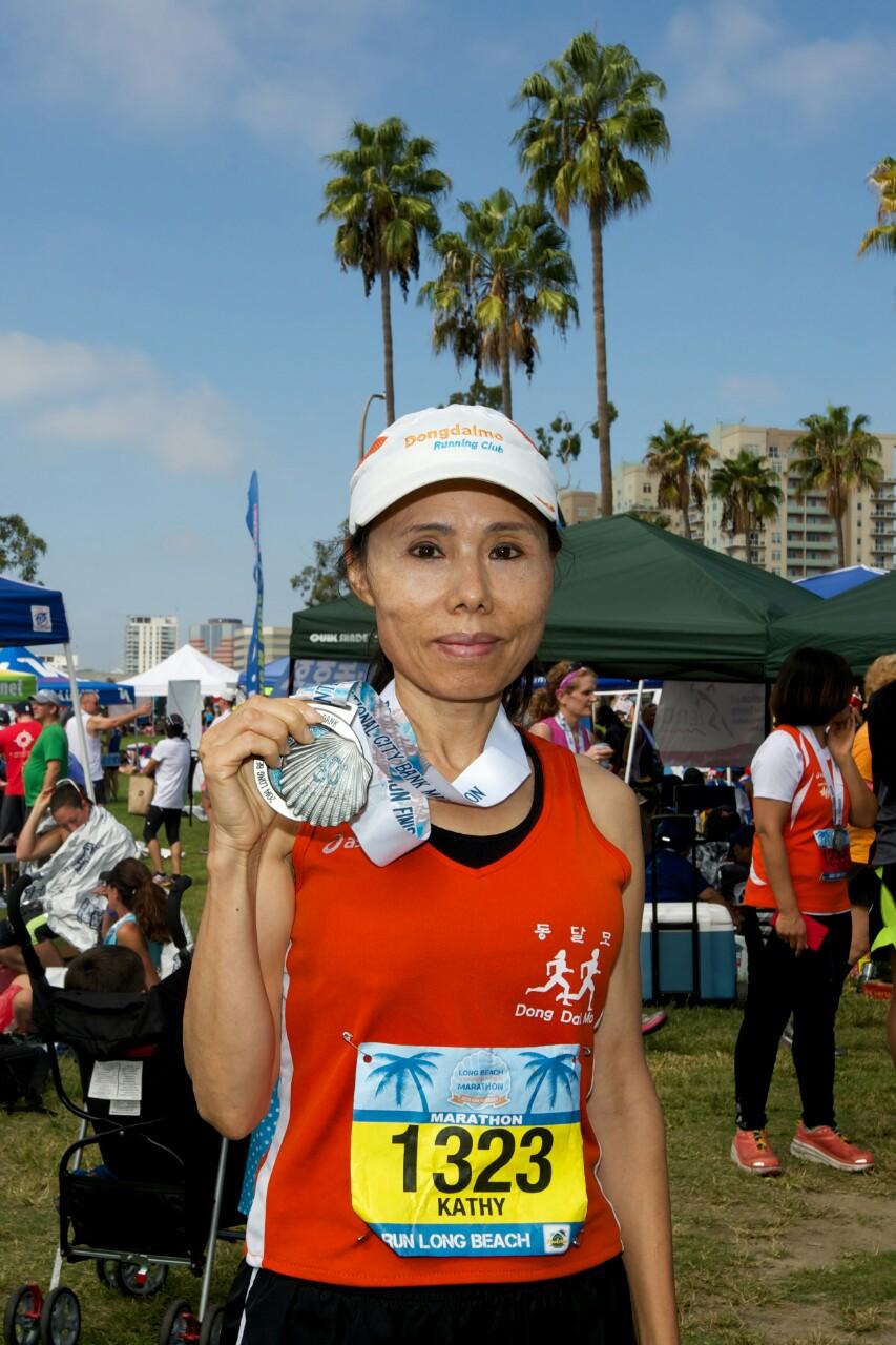 Kathy Joo won the females age 60-64 category at the Long Beach Marathon Sunday.