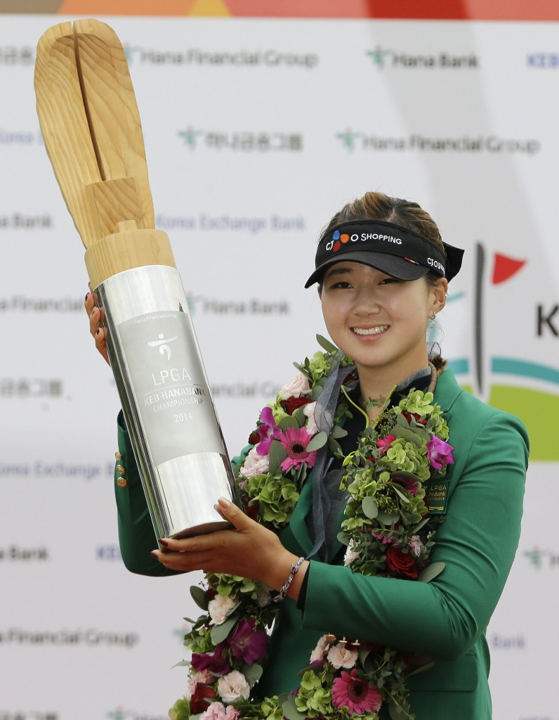 Baek Kyu-jung of South Korea poses with the trophy for the media after winning the KEB Hana Bank Championship golf tournament at Sky72 Golf Club in Incheon, South Korea, Sunday, Oct. 19, 2014. (AP Photo/Ahn Young-joon)