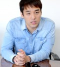 Singer Han Hee-jun discusses Milal Night 2014 at The Korea Times Los Angeles Thursday. (Kim Young-jae/The Korea Times)