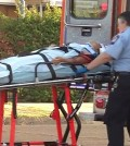 A female victim is being transported to hospital. (KBFX-TV screen capture)