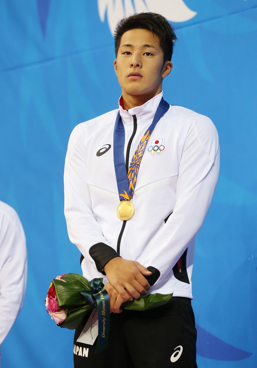 Japan's Daiya Seto stands on the podium after winning the men's 200-meter butterfly swimming final at the 17th Asian Games in Incheon, South Korea, Sunday, Sept. 21, 2014 .(AP Photo/Rob Griffith)