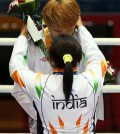 Sarita Devi slips the bronze medal around South Korea's silver medalist Park Jin-a's neck. The Korean appeared too stunned to immediately react. (Yonhap)