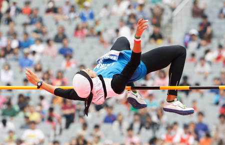 Iran's Sepideh Tavakoly Nik makes an attempt in the high jump of the women's heptathlon at the Asiad Main Stadium in Incheon, Sunday. (AP)