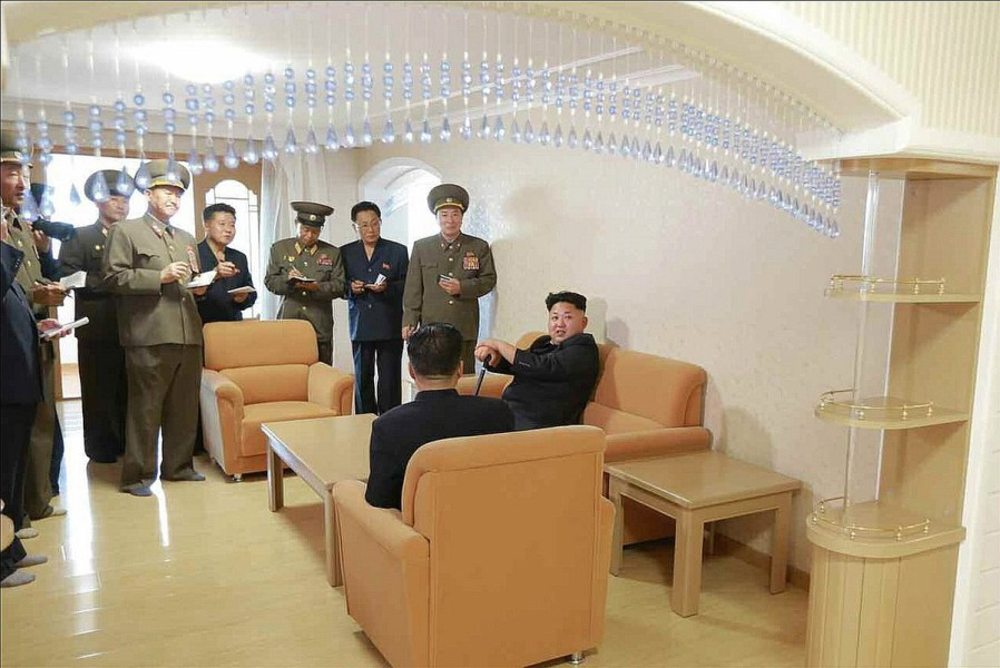 North Korean leader Kim Jong-un with a cane sits on a couch during a visit to a faculty flat at the Kim Chaek University of Technology in Pyongyang. (KCNA-Yonhap)