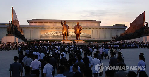 People gather a day before the 20th anniversary of former North Korean leader Kim Il-sung's death in Pyongyang. (Yonhap)