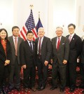 Peter Koo, fourth from left, stands with Korean American community representatives. (The Korea Times)