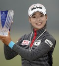 South Korean golfer Lee Mi-hyang holds up her trophy after winning her first LPGA Tour victory at the Mizuno Classic held at Kintetsu Kashikojima Country Club in Shima, Japan on Nov. 9, 2014. (Yonhap)