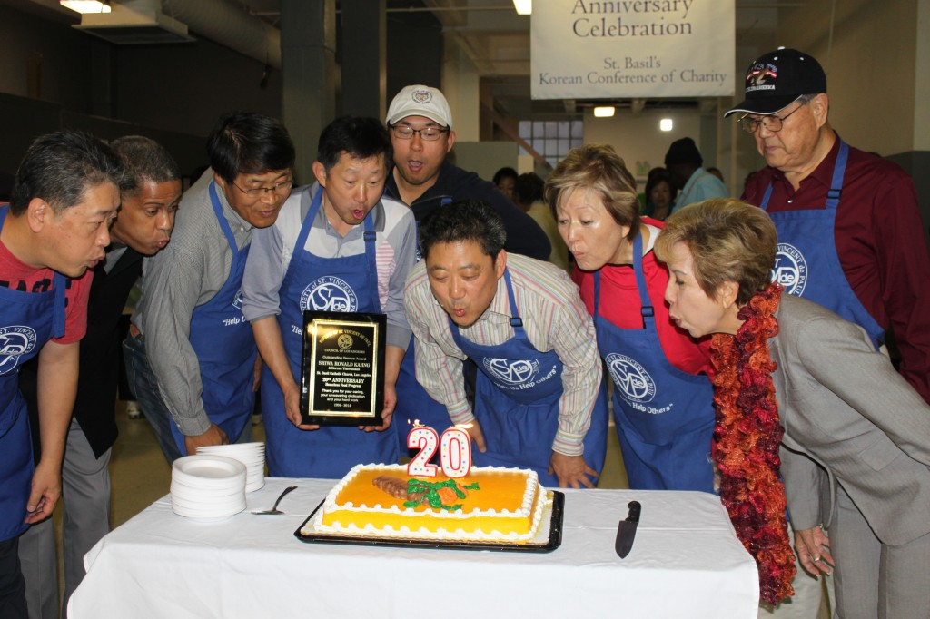 Korean Vincentians and SVDP-LA officials blow out candles on the 20th anniversary cake.