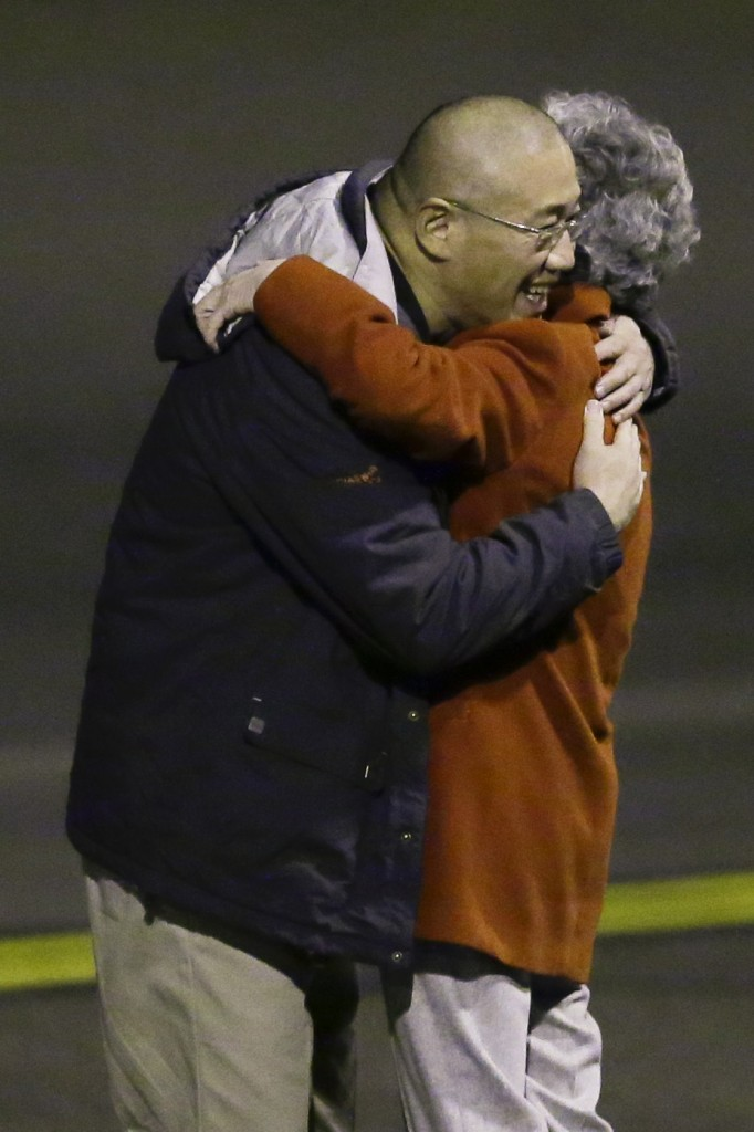 Kenneth Bae, left, who had been held in North Korea since 2012, hugs his mother Myunghee Bae after arriving, Saturday, Nov. 8, 2014, at Joint Base Lewis-McChord, Wash., after they were freed during a top-secret mission by James Clapper, U.S. director of national intelligence. (AP Photo/Ted S. Warren)