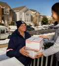 U.S. Postal Service letter carrier delivering packages during the holidays (PRNewsFoto/U.S. Postal Service)