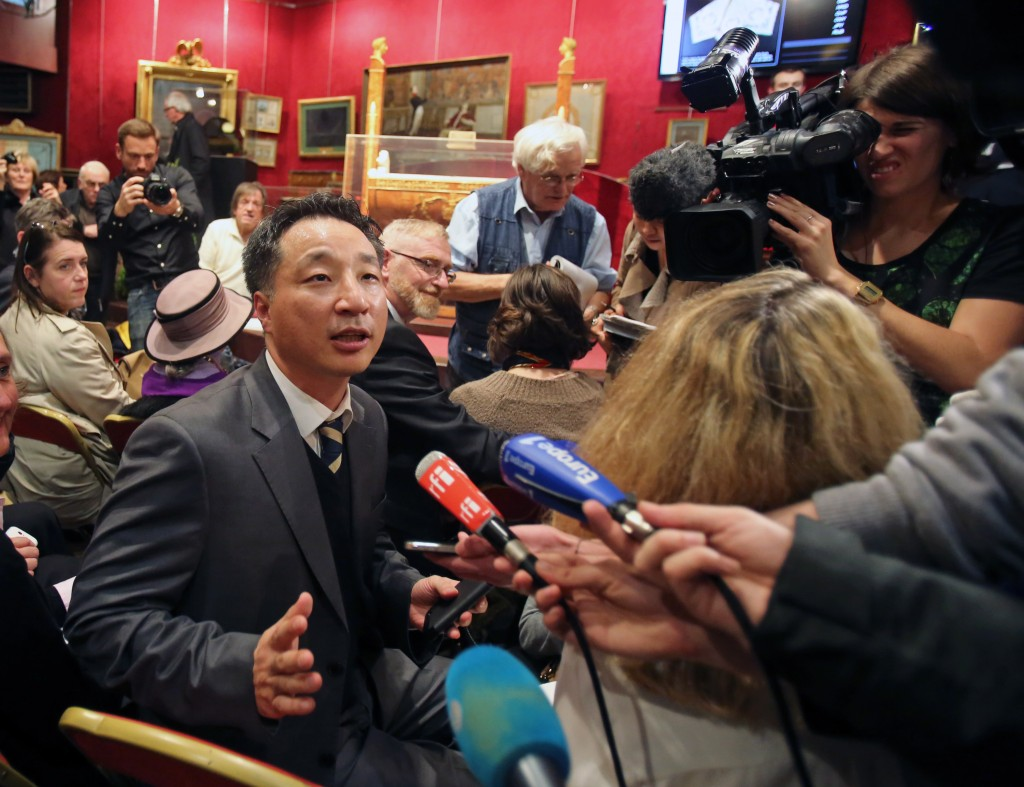 Korean businessman Lee Tae Kyun faces reporters after buying Napoleon's hat at its auction in Fontainebleau, south of Paris, Sunday Nov. 16, 2014. Napoleon Bonaparte's famous bicorn hat was sold 1.5 million euros (1,930,000 US Dollars). One of Napoleon Bonaparte's famous hats was among over 1,000 items relating to the French general that were auctioned near Paris this weekend. (AP Photo/Remy de la Mauviniere)