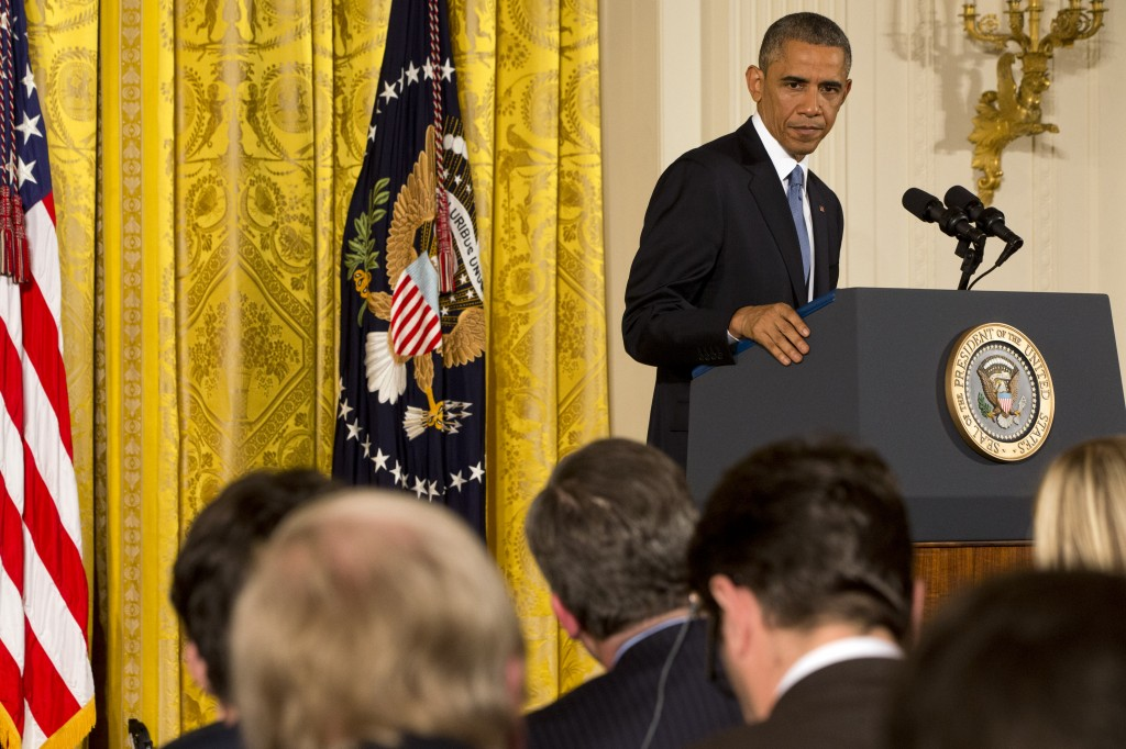 """President Barack Obama looks at reporters during a news conference in the East Room of the White House, Wednesday, Nov. 5, 2014, in Washington. Obama is telling Americans who voted for change: """"I hear you."""" The president said the Republican victories Tuesday in the midterm elections are a sign they want Washington """"to get the job done.""""   (AP Photo/Jacquelyn Martin)"""