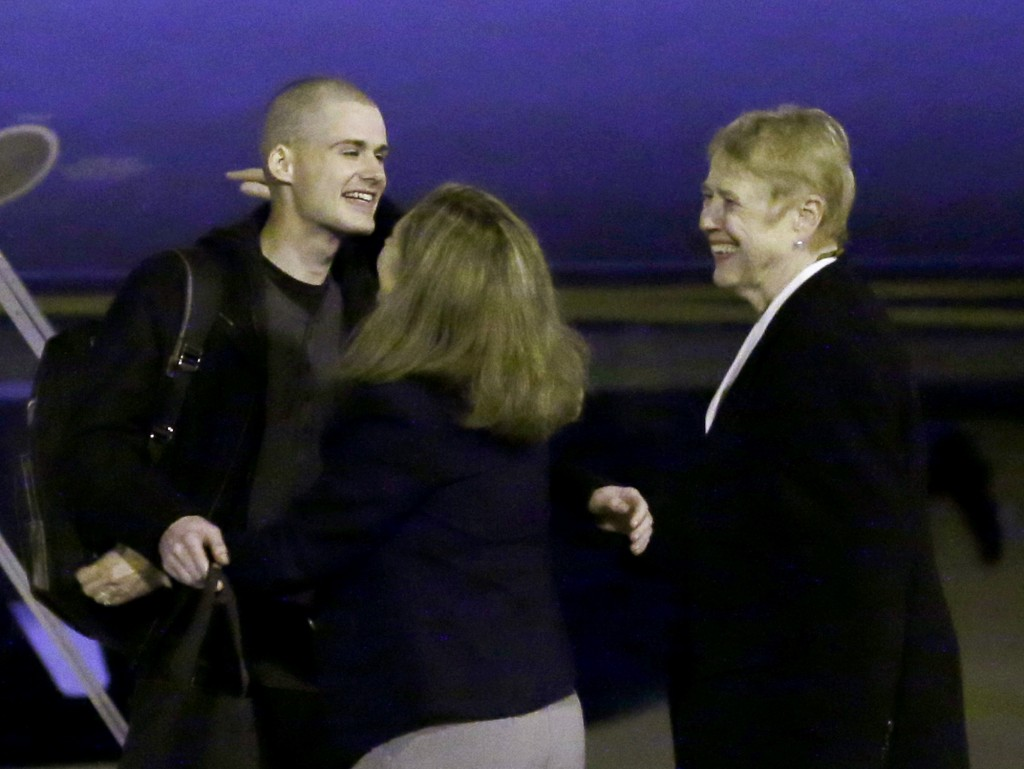 Matthew Miller, left, who had been held in North Korea since April, 2014, is greeted after arriving Saturday, Nov. 8, 2014, at Joint Base Lewis-McChord, Wash., after he were freed during a top-secret mission. (AP Photo/Ted S. Warren)