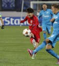 Leverkusen's Son Heung-min, center, tries to score during the Champions League group C soccer match between Zenit St. Petersburg and Bayer 04 Leverkusen in St.Petersburg, Russia, Tuesday, Nov. 4, 2014. (AP Photo/Dmitry Lovetsky)