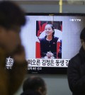 """A TV screen shows Kim Yo Jong, North Korean leader Kim Jong Un's younger sister, at Seoul Railway Station in Seoul, South Korea, Thursday, Nov. 27, 2014. North Korea has revealed that Kim is a senior official in the ruling Workers' Party, strengthening analysts' views that she is an increasingly important part of the family dynasty that runs the country. The letters read """"Kim Jong Un's sister"""". (AP Photo/Ahn Young-joon)"""