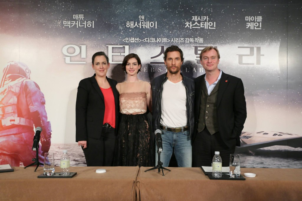 """From the right, director Christopher Nolan and actors Matthew McConaughey and Anne Hathaway of the American sci-fi film """"Interstellar"""" pose for photographers during a news conference held at a Shanghai hotel on Nov. 10, 2014, to promote the film. (Yonhap)"""