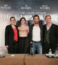 "From the right, director Christopher Nolan and actors Matthew McConaughey and Anne Hathaway of the American sci-fi film ""Interstellar"" pose for photographers during a news conference held at a Shanghai hotel on Nov. 10, 2014, to promote the film. (Yonhap)"