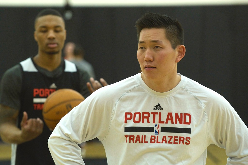 "Portland Trail Blazers video coordinator, Jonathan Yim contributes in every way he can, even in activities outside of his prescribed responsibilities, including rebounding during shooting drills as seen here with All-Star guard Damian Lillard, who has nicknamed Yim ""Jonny-on-the-spot."""