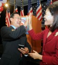 Irvine Mayor Choi Seok-ho, left, and Orange County Supervisor Michelle Park Steel celebrate their general election victories Tuesday night. (Park Sang-hyuk/The Korea Times)
