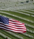 A U.S. Flag flies over war veterans tombstones at Golden Gate National Cemetery in San Bruno, Calif. (AP)