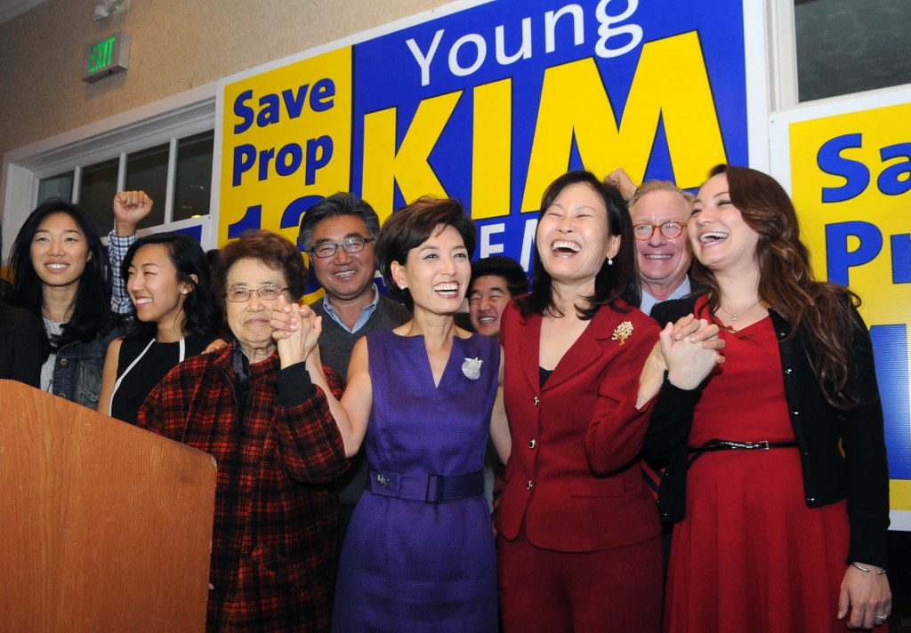 Candidates Young Kim, fifth from left, and Michelle Park Steel, second from right, celebrate after their general election victories Tuesday night. (Park Sang-hyuk/The Korea Times)