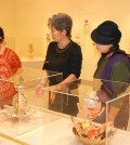 Artist Teresa Hwang, center, explains her exhibition to visitors Saturday. (Park Heung-ryul/The Korea Times)