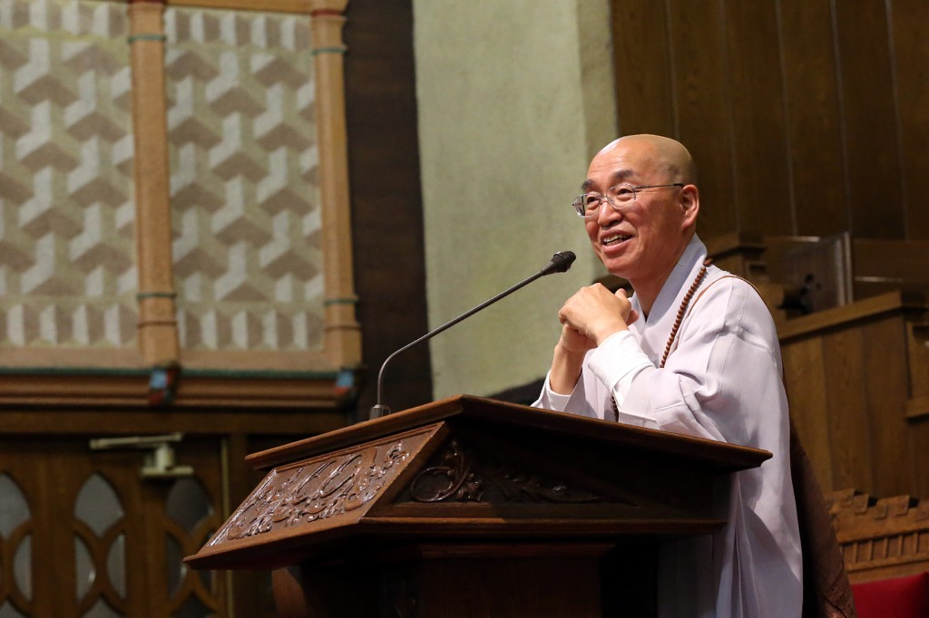 Venerable Pomnyun Sunim speaks inside the Church of Jesus Christ of Latter-day Saints in Koreatown Saturday.