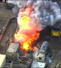In this aerial still frame from video provided by Fox 11 LA, a waste treatment facity burns after an unstable chemical mixture exploded in Santa Paula, Calif., early Tuesday, Nov. 18, 2014, sending about 30 people to the hospital for decontamination and prompting an order to evacuate for a mile around the plant, authorities said. No burn injuries were reported, but two drivers on a vacuum truck, three firefighters, hospital medical staff and a few nearby residents were washed down or treated for complaints such as breathing problems, red eyes and skin rashes, said Lori Ross, a spokeswoman for the Ventura County Fire Department. The vacuum truck was delivering a load around 3:45 a.m. when it exploded at the Santa Clara Waste Water Co., authorities said. (AP Photo/Fox 11 LA)