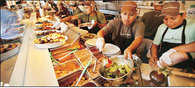 Tender Greens workers prepare lunch for customers in Santa Monica. (Los Angeles Times photo)