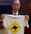 "U.N. Secretary-General Ban Ki-moon holds up a T-shirt that reads, ""No kangaroos in Austria"" after mistakenly saying ""Australia"" instead of ""Austria"" at a U.N. Conference in Vienna, Monday. (Yonhap)"