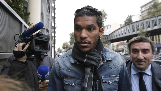 Brandao, center, and his lawyer Olivier Martin. (AP)