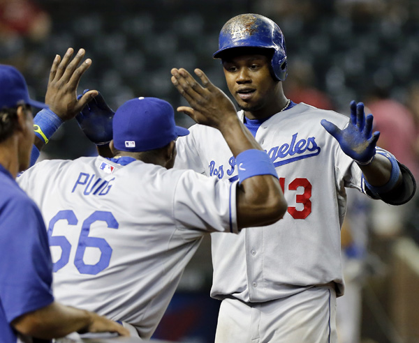 Hanley Ramirez, right, won't be high-fiving Yasiel Puig anymore.