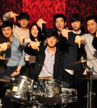From left, Edward Soo-min Han (Keyboard), David Dong-jin Kim (Guitar), Andrew Sunghwan Kim (Vocal), Ashley JungAh Chung (Vocal), Marvin Won-bin So (Drum), Paul Jin-wang Yoo (Vocal), Philip Hyung-ho Shin (Guitar), Gerry Hyung-joo Nam (Bass), Alex Yeon-Sung Jung (Director, Manager)