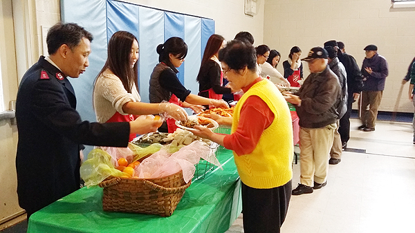 Salvation Army Flushing Corps in New York gives out lunch to local seniors Saturday.