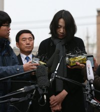Cho Hyun-ah, the eldest daughter of Korean Air Chairman Cho Yang-ho and former vice president of the airline company, appears at Aviation and Railway Accident Investigation Board in western Seoul on Dec. 12, 2014, to be questioned for ordering a crew member to leave a plane over an alleged breach of snack-serving protocol. (Yonhap)