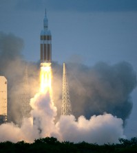 The NASA Orion space capsule atop a Delta IV rocket, in its first unmanned orbital test flight, lifts off from the Space Launch Complex 37B pad at the Cape Canaveral Air Force Station,  Friday, Dec. 5, 2014, in Cape Canaveral, Fla. (AP Photo/John Raoux)