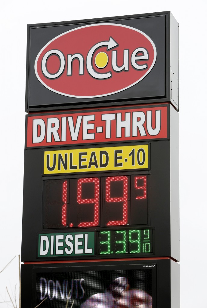 A sign displays the price for E-10 gasoline for $1.99 at the OnCue convenience store and gas station, Wednesday, Dec. 3, 2014, in Oklahoma City. (AP Photo/The Oklahoman, Paul B. Southerland)