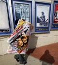 """A poster for the movie """"The Interview"""" is carried away by a worker after being pulled from a display case at a Carmike Cinemas movie theater, Wednesday, Dec. 17, 2014, in Atlanta. Georgia-based Carmike Cinemas has decided to cancel its planned showings of """"The Interview"""" in the wake of threats against theatergoers by the Sony hackers. (AP Photo/David Goldman)"""