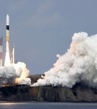 An H2-A rocket carrying space explorer Hayabusa2, lifts off from a launching pad at Tanegashima Space Center in Kagoshima, southern Japan, Wednesday, Dec. 3, 2014. The Japanese space explorer was launched Wednesday on a six-year roundtrip journey to blow a crater in a remote asteroid and collect samples from inside in hopes of gathering clues to the origin of earth. (AP Photo/Kyodo News)