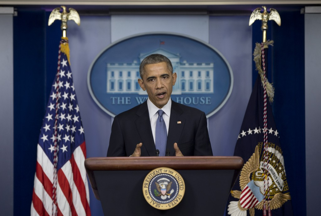 "President Barack Obama declared Friday that Sony ""made a mistake"" in shelving the satirical film, ""The Interview,"" about a plot to assassinate North Korea's leader. He pledged the U.S. would respond ""in a place and manner and time that we choose"" to the hacking attack on Sony that led to the withdrawal. The FBI blamed the hack on the communist government. (AP Photo/Carolyn Kaster)"