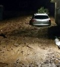 This photo provided by the Glendora Police Department shows a driveway covered in mud in a neighborhood of the suburb of Glendora, Calif. on Friday, Nov. 21, 2014. Rare Southern California rains triggered mudslides in an area of the Los Angeles-area foothills scorched bare by a wildfire earlier this year. Los Angeles County Fire Department Dispatch Supervisor Robert Diaz says a 4-foot-high flow of debris hit a home in the suburb before dawn. (AP Photo/Glendora Police Department)
